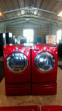 red front-load clothes washer and dryer set Del Valle