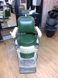 green and white leather padded armchair 353 mi