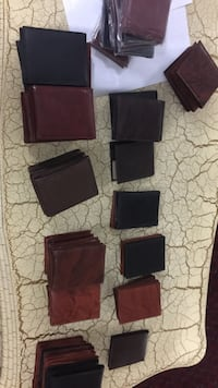 Brown and black leather bifold wallet lot  Toronto, M3C 1A2