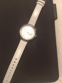 Round silver-colored analog watch with white leather strap