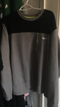 gray and black Nike sweatshirt Delta, V4C 3T3