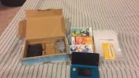 blue Nintendo 3DS with game cases 1155 mi