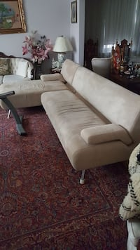 white fabric sectional sofa with throw pillows