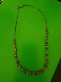 silver and red beaded necklace 616 mi