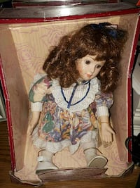 girl in brown and white dress porcelain doll