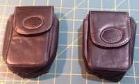 Two brown leather Roots camera cases