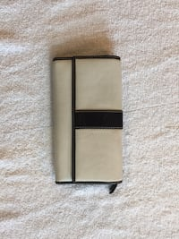 Coach wallet. Off white w/ dark navy blue trim. Gently used: some light Mark's on back   Arlington, 22206