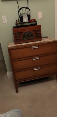 Nice wood 3 drawer chest.  Solid wood, roomy drawers.  One leg slightly damaged, however, no issue. Tampa, 33629