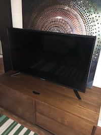black flat screen TV with remote Los Angeles, 91316