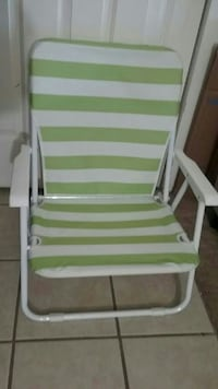 green and white wooden rocking chair