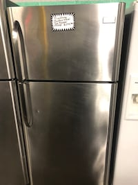 Frigidaire stainless steel top freezer fridge  Baltimore, 21223