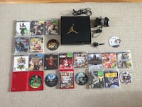 black Sony PS3 slim console with controller, bluetooth headset and games!