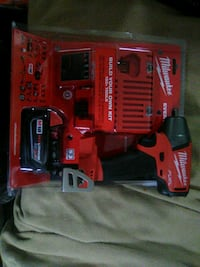 red and black Milwaukee cordless impact driver wit Spartanburg, 29303
