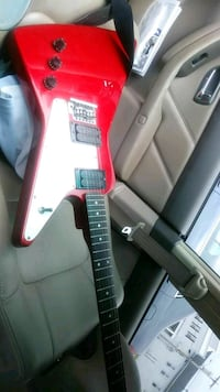 red and black electric guitar Hudson, 01749