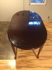 oval black wooden center table Royal Kunia, 96797