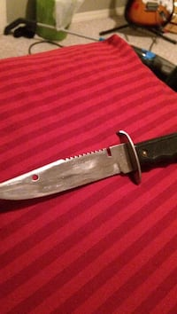 black handled combat knife 3483 km