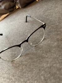 Black and silver framed personality glasses 71 km