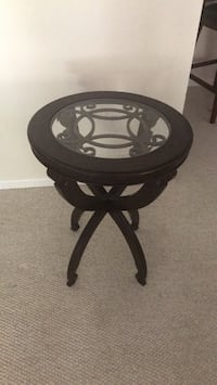 round black wooden framed glass top table Great Falls, 22066