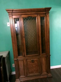 brown wooden framed glass display cabinet Bakersfield, 93307