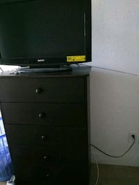 black flat screen TV with black wooden TV stand Long Beach, 90815