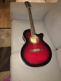 red burst cut away acoustic guitar