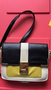 Women's black, white, and yellow leather shoulder bag
