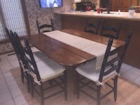 """Drop-Leaf Table with 6 Ladderback Chairs  The Table is pine (from Habersham Plantation) It measures 60"""" Length x 43 1/2"""" Width (with sides up) or 21 1/2"""" ( with sides down) Each chair comes with a seat cushion from Pottery Barn. Table has a few marks. The Overland Park, 66214"""