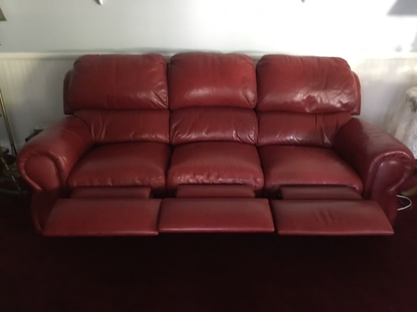 Red leather reclining sofa from Arizona Leather 7 1/2 ft. Incliner style.