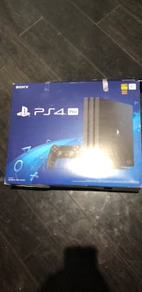 Sony ps4 pro console 1tb with 4 games and controller  Windsor, N9C 2S6