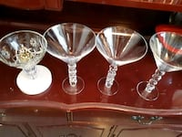 four clear glass candle holders Hamilton, L8W 3J2