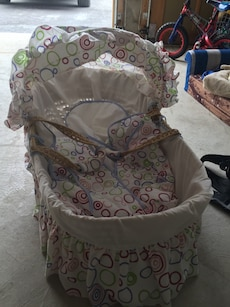 baby's white polka dot bassinet