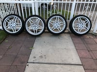 four gray 5-spoke vehicle wheels and tires 2259 mi