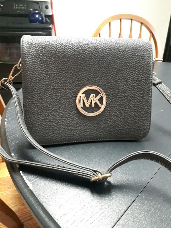 aae8400261ac Used Grey leather Michael Kors over the shoulder bag for sale in Surrey -  letgo