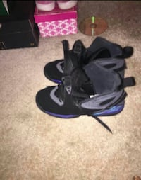 black-and-purple Air Jordan shoes
