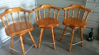 3 stained swivel chairs Rock Hill