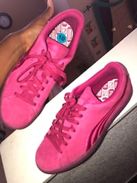 All pink sued Pumas (negotiable) size 10 in men, 12 in women Lancaster, 93535