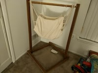 brown wooden framed white fabric cradle