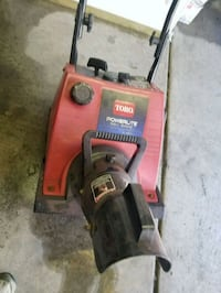 red and black Toro snow blower
