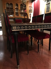 Genuine Art Deco dining room table and 8 upholstered chairs. Tempered glass top included. Circa 1930. This is a very unique set. Two chairs need some work for stability but all upholstery is perfect.  [TL_HIDDEN]  Barrie, L4M 1S9