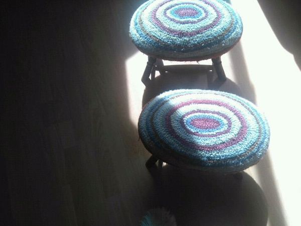 two multicoloured stools