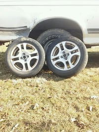 Saturn ion 4x100 Rim with decent tires Martinsburg, 25405