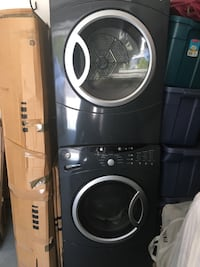Dark grey GE front loading washer and dryer