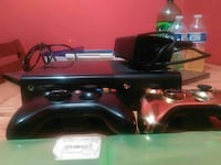 Xbox 360 E console with two controllers and one AC adapter Manassas, 20109