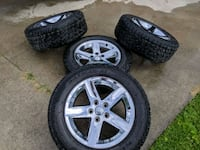 13' Ram 1500 Factory Rims and tires Swan