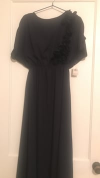 Brand new long navy dress with open back-tag still attached  Decatur, 35601