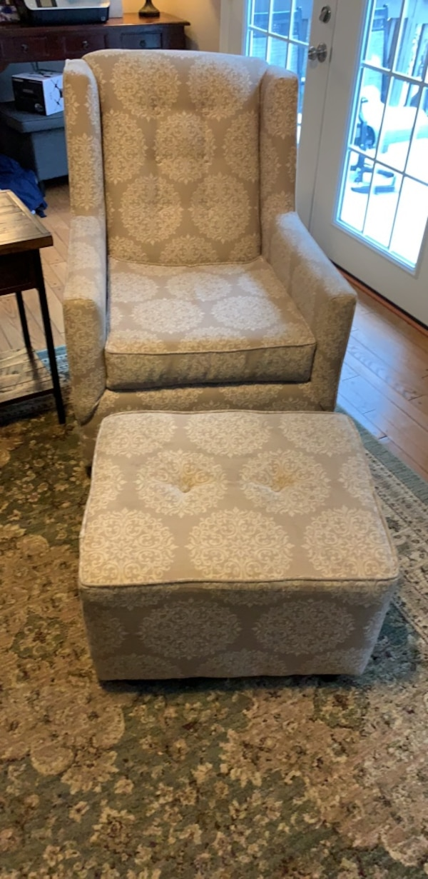 Rocking/swivel chair with glider foot rest.