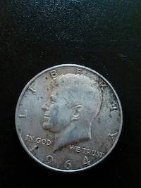 1964 round silver-colored Liberty coin