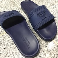 Pair of black leather slide sandals Chico