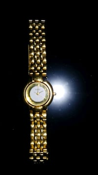 Guess woman's vintage watch gold tone