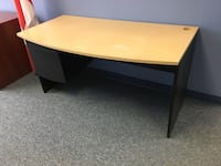 yellow and black wooden single pedestal desk